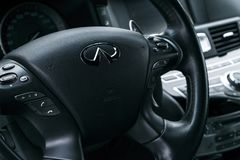Infiniti Q70S AWD close up of steering wheel with navigation screen multimedia system. Modern luxury car interior details. Sankt-Petersburg, Russia, January 04 Stock Photos
