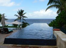 Infinitive Seychelles. An Infinity pool at the Banyan Tree Resort in the Seychelles royalty free stock photography