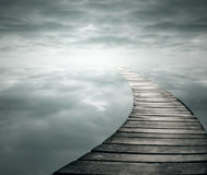 Infinity. Beautiful poetic background with a wooden footbridge into the infinity sky Royalty Free Stock Images