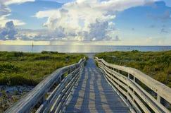 Infinity Bridge. Bridge leading to the ocean stock photography