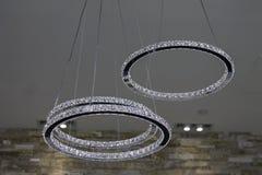 Infinity circles. The rings of crystals hang above Stock Photo