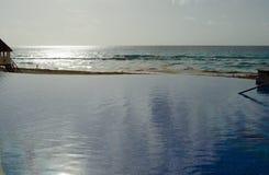 Infinity edge swiming pool stock photo