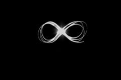 Infinity from light in the dark room royalty free stock photography