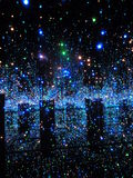 Infinity Mirrored Room Filled with the Briliants of Life  Yayoi Kusama. Star like illumimination with blue and green lights - Guggenheim Yayoi Kusama artistic Stock Image