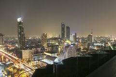 Infinity pool in Bangkok at night with view of cityscape Stock Photos