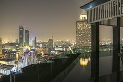 Infinity pool in Bangkok at night with view of cityscape Stock Photography