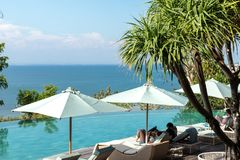 Infinity pool on the bright summer day. Bali island. royalty free stock photo