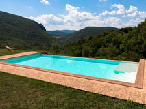 Infinity pool on a bright summer day Royalty Free Stock Photo