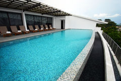Infinity Pool Design, Roof Top Of Resort Hotel Stock Photo