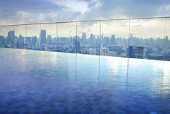 Infinity pool on high condominuim building Stock Images