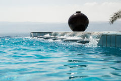 Infinity pool jacuzzi with azure water. Luxury lifestyle, recreation concept. Stock Photography