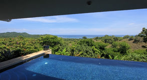 Infinity pool of a luxury house with view of the rainforest and beach, Costa Rica Stock Photography
