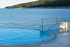 Infinity pool and mountains Royalty Free Stock Photo