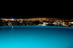 INFINITY POOL NIGHT SKYLINE Royalty Free Stock Image