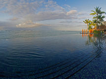 Infinity Pool Over Hawaii Ocean Panoramic. This pool overlooks the Ocean in Waikiki Royalty Free Stock Photography