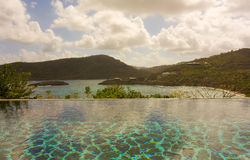 An infinity pool overlooking a bay in the windward islands Stock Image