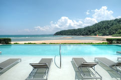 Infinity pool overlooking Cherating Beach, Kuantan, Malaysia. Cherating Beach, Club Med Kuantan in Malaysia royalty free stock images