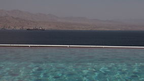 Infinity pool overlooking the Gulf of Aqaba Eilat Israel stock video