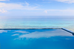 Infinity pool overlooking the sea Stock Photos