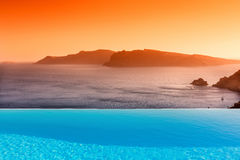 Infinity pool on the rooftop with the ocean in Santorini Island, Royalty Free Stock Photos