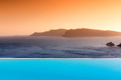 Infinity pool on the rooftop with the ocean in Santorini Island, Stock Photos