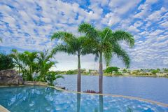 Infinity Pool with Views over canal Stock Images