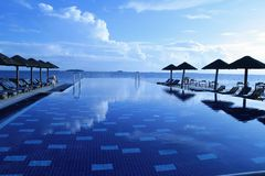 Infinity pool on waterfront Royalty Free Stock Photos