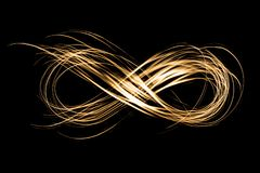 Infinity sign created by neon freeze light on a black background. Infinity sign created by golden neon freeze light on a black background royalty free stock photos