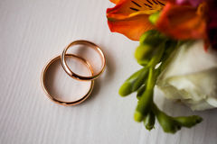 Infinity sign of the rings, wedding rings on a white background. Wedding bands stock photography