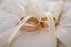 Infinity sign of the rings, wedding rings on a white background. Wedding bands, wedding rings on a cushion Stock Photography
