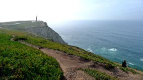 Infinity Cabo de roca Portugal. The sky and the sea on the cliff of most extreme point of Europe royalty free stock image