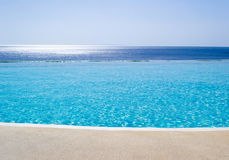 Infinity swimming pool with view on Aegean Sea Royalty Free Stock Photos