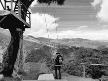 Infinity swing. Black&white tree house mountain top landscape Royalty Free Stock Photography