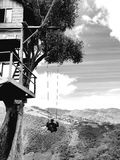 Infinity swing. Black&white tree house mountain top landscape Stock Photography