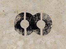 Infinity symbol painted black on concrete wall background. Infinity symbol painted black on old rugged concrete light grey wall background Stock Photo