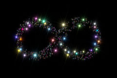 Infinity symbol stars. Infinity symbol composed of variegated sparkling twinkling stars isolated on black background stock images