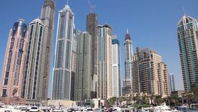 Infinity tower and skyscrapers of Dubai Marina in United Arab Emirates. Dubai Marina, United Arab Emirates. Dubai Marina (United arab emirates) - the largest man stock footage