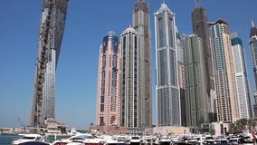 Infinity tower and skyscrapers of Dubai Marina in United Arab Emirates stock footage
