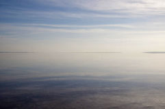 Infinity. The water surface, sky and it's reflection on salt lake Tuz Golu in Turkey Stock Image
