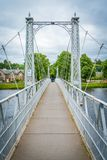 Infirmary Bridge in Inverness on a summer morning, Scottish Highlands. Inverness is a city on Scotland's northeast coast, where the River Ness meets the Moray Royalty Free Stock Images