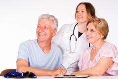 Infirmière avec des patients photographie stock