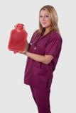 Infirmière avec la bouteille d'eau chaude Photographie stock libre de droits