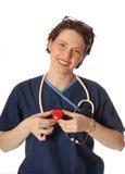 Infirmière avec le coeur Images libres de droits