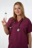 Infirmière avec le grand pointeau Photo stock