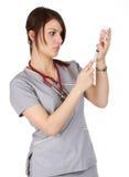Infirmière et pointeau photo stock