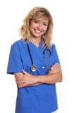 Infirmière heureuse riant de l'appareil-photo Photos libres de droits