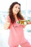 Infirmière heureuse With Salad photo stock