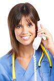 Infirmière avec le téléphone Images libres de droits