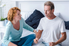 Inflamed aged couple quarreling Stock Photos