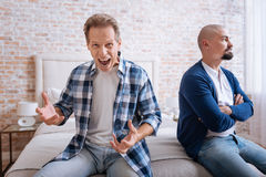 Inflamed man screaming loudly at home Royalty Free Stock Image